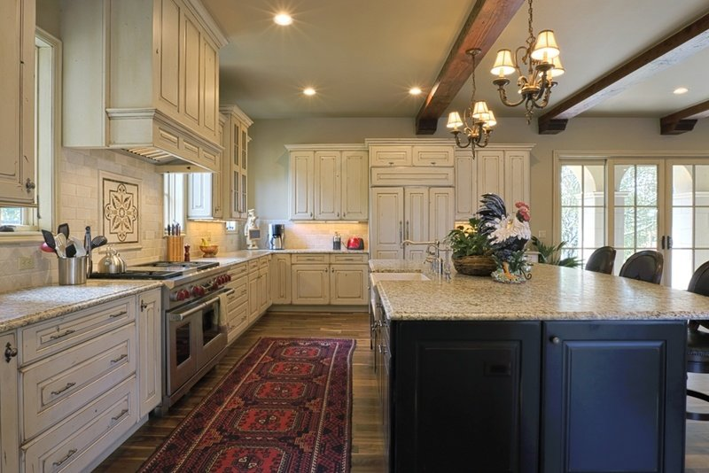 A rug can add a nice splash of colour to your kitchen.